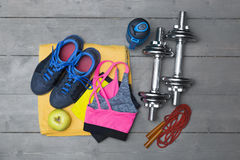 Top view of colorful fitness equipment on wooden floor Royalty Free Stock Photo
