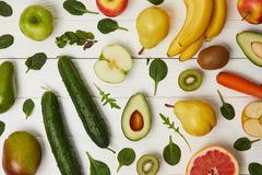 Top view of colorful fruits and vegetables on wooden background Stock Photography