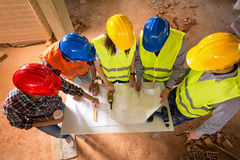 Top view of colorful hard hats of architects at construction sit Stock Image