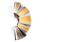 Top view of colorful hardback books in a circle. Open book, fanned pages. Back to school copy space. Education. Background stock images