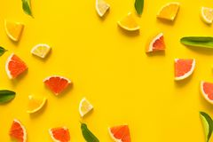 Top view of colorful orange fruit on yellow pastel background. stock photos