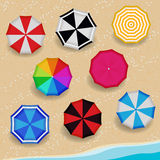 Top View Colorful Pattern color Umbrella on the Beach Royalty Free Stock Photos
