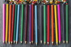 Colorful pencil row. Top view of colorful pencil row on wooden desktop. Art and imagination concept Stock Images