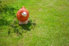 Top view of colorful sheep statue or sculpture standing on green grass meadow field of outdoor garden. Selective focus stock image
