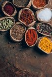 top view of colorful spices in paper bags royalty free stock photo