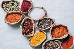 top view of colorful spices in paper bags stock photo