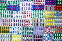 Top view of colorful tablets and capsule pills in blister packaging arrange with beautiful pattern. Pharmaceutical industry Royalty Free Stock Photography