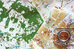 Colorful topographic map for orienteering. Top view of colorful topographic map for orienteering or rogaining sport and compass. Concept of orenteering and Royalty Free Stock Image