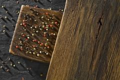 Rustic wooden desk and black table background with colour pepper royalty free stock image