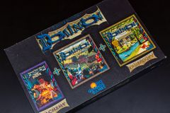 Top View of colourful deck building card game of Dominion the Big Box royalty free stock photo