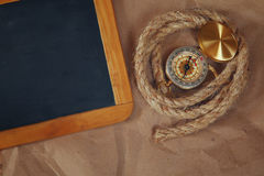 Top view of compass, rope and blank blackboard Royalty Free Stock Photos