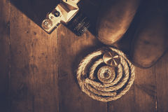Top view of compass, rope, hiking boots and old camera Royalty Free Stock Photography