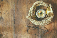 Top view of compass, rope, old glasses Stock Photo