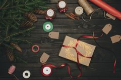 Beautiful christmas gift with red bow. Top view of composition of beautiful christmas gift with red bow Royalty Free Stock Images