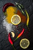 Composition with lemon oriental spices scattered and peppers on the black metallic tray in Asian style stock photo