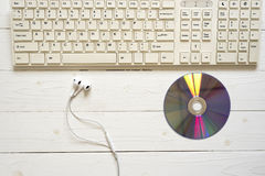 top view of computer keyboard dvd disc and earphone Royalty Free Stock Image