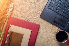 top view of a computer, laptop, notebook, pen, cup coffee and of Royalty Free Stock Photo
