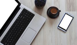 Top view of computer, phone, coffee, and flower stock photo stock image