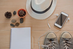 Top view Concept travel accessories. Hat, book, phone, shoes, Earphone on wooden background. Stock Image