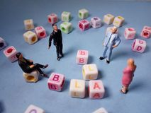 Top View Conceptual / Illustration Chit Chat, Alphabet Plastic Cube Beads Beyond 3 Miniature Figure Businessman and 1. Photo Top View Conceptual / Illustration stock photos