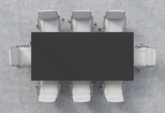 Top view of a conference room. A black rectangular table and eight chairs around. 3D interior. Stock Photos
