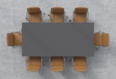 Top view of a conference room. A dark grey rectangular table and eight brown leather chairs around. 3D interior. Stock Photos