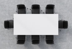 Top view of a conference room. A white rectangular table and eight black leather chairs around. 3D interior. Stock Photos