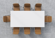 Top view of a conference room. A white rectangular table and eight brown leather chairs around. 3D interior. Royalty Free Stock Photography