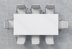 Top view of a conference room. A white rectangular table and eight chairs around. Royalty Free Stock Photos