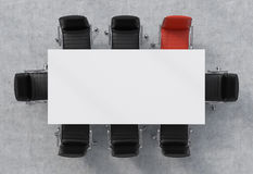 Top view of a conference room. A white rectangular table and eight chairs around, one of them is red. 3D rendering. Stock Image