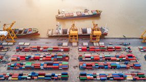 Top view of container and crane, container ship in import export and business logistic cargo to harbor Stock Image
