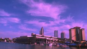 Top view of Convention Center and colorful boats on sunset sky background in downtown area. stock footage