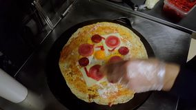 Cook preparing a crepe with cheese, Turkish sauge (sucuk) and egg. Top view of a cook preparing a crepe with cheese, Turkish sauge (sucuk) and egg stock footage