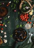 Top view of cooked mussels with shells served in pan with tomatoes, herbs and wine. On wooden table Royalty Free Stock Photo