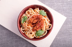 Top view of cooked spaghetti with tomato relish Stock Image