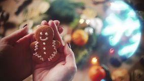 Cookie man in hands. Top view cookie man in hands on blurred decorate background, and figure bokeh