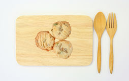 Top view of a cookies on wood board with fork and spoon Stock Photos