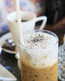 Top view of cool capuccino coffee on desk Stock Images