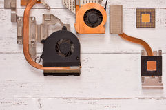 Top view of cooling system on white shabby wooden background.Heatpipe and radiators,microprocessor. Stock Image