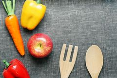 Top view with copy space. Fresh colorful Vegetables on gray textured background with wooden spoon and fork. Top view with copy space. Fresh colorful Vegetables Royalty Free Stock Photos