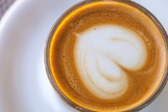 Top view of cortado coffee in a glass with the foam in shape of heart.  Royalty Free Stock Photography