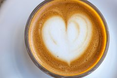 Top view of cortado coffee in a glass with the foam in shape of heart.  Stock Image