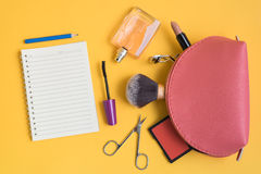 Top view of cosmetic bag with makeup items Royalty Free Stock Photo