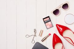 Top view of cosmetics and female accessories. Woman Essentials. Top view of cosmetics and female accessories. Woman Essentials Stock Image