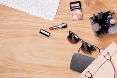 Top view of cosmetics and female accessories. Woman Essentials. Top view of cosmetics and female accessories. Woman Essentials Royalty Free Stock Image