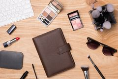 Top view of cosmetics and female accessories. Woman Essentials. Top view of cosmetics and female accessories. Woman Essentials Royalty Free Stock Photography