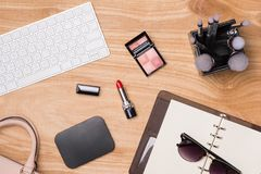 Top view of cosmetics and female accessories. Woman Essentials. Top view of cosmetics and female accessories. Woman Essentials Stock Photos