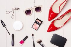 Top view of cosmetics and female accessories. Woman Essentials. Top view of cosmetics and female accessories. Woman Essentials Stock Photo