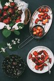 Top view of cottage cheese and fresh ripe summer berries. On black royalty free stock images