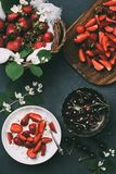 Top view of cottage cheese, jasmine flowers and fresh ripe summer berries. On black stock photos